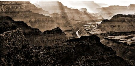 Dramatic sunbeams hgihlight cliffs at Grand Canyon Nationall Park near Pima Point as sun glints off a slice of the Colorado River below Arizona Cliff Colorado River Eroded Geology Grand Canyon National Park Idyllic Landscape Lighting Majestic Nature Neutral Colors Rock Formation Sandstone Sepia Shadows Southwestern Sunbeams Tourism Tranquil Scene Tranquility Vintage Photo Weather First Eyeem Photo