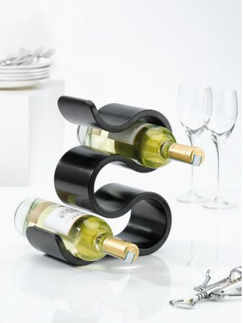 Koziol BOA Bottle Rack. This funky designer wine rack consists of a unique curved plastic shape which doubles back on itself several times to create five openings.