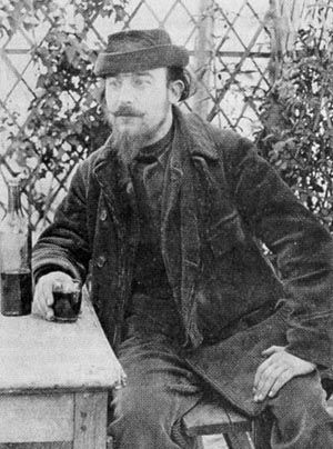 Erik Satie having a drink. 50 Rare and Unseen Photos of Composers In Their Everyday Life.