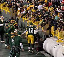 Rodgers, greeting the fans in Lambeau Field