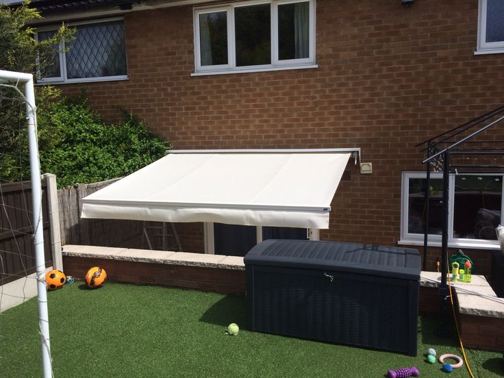 Patio awning in cream creates a perfect shaded area, ideal for the summer months Www.apollo-blinds.co.uk