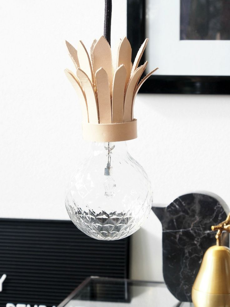 DIY Tropical Pendant Light The best fruit for interior impact is just deliciously gorgeous. Opt for a tropical statement with these pineapple pendant lights