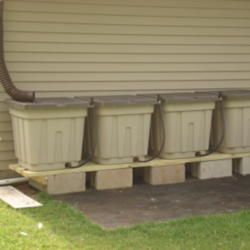 another cheap, effective way to save & store water from roof runoff. Two things to remember: 1) use pvc pipe to connect tubs so that excess water flows from the full one, into the next and (2) place them at least 2 blocks high so the gravity flow will allow for soaker hoses to be installed.