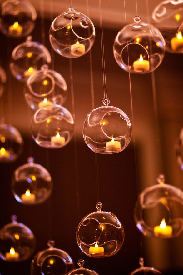 tealights inside glass ornaments.  Get the new LED lights that will flicker like a candle does. Plus no wax to clean up.