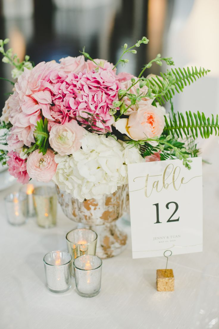 Hydrangea and ranunculus wedding table florals: Floral Design: Lotus & Lily  - http://www.stylemepretty.com/portfolio/lotus-and-lily- Coordination: Modern LA Weddings (Nam Lam) - http://www.stylemepretty.com/portfolio/modern-la-weddings-(nam-lam) Venue: Vibiana - http://www.stylemepretty.com/portfolio/vibiana   Read More on SMP: http://www.stylemepretty.com/california-weddings/2017/02/02/garden-inspired-wedding-smack-dab-in-the-middle-of-los-angeles/