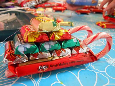 Candy Sleigh:  2 candy canes for runners.  KitKat as base.  10 Hershey's miniatures stacked in a pyramid.  Hot glue together, wrap in ribbon and look fabulous.