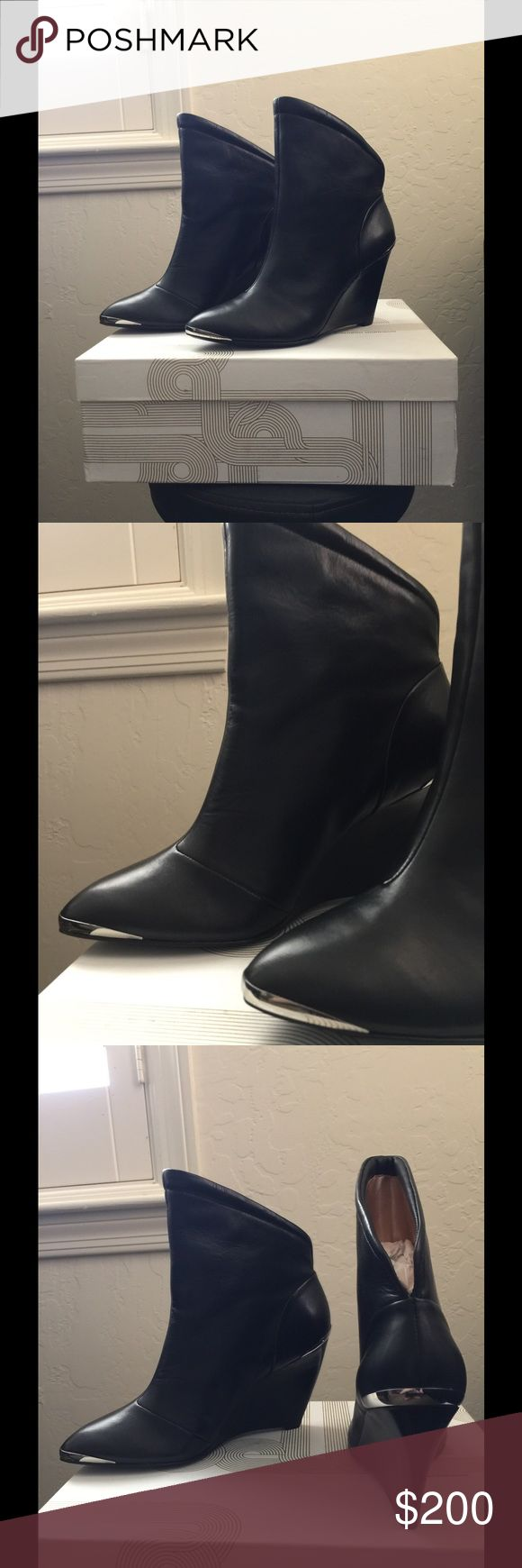 Belle by Sigerson Morrison boots 6611 These gorgeous black leather Sigerson Morrison boots have never been worn! Very rock n roll with silver details on the toe and heel. These hard find booties come from a smoke free home. Belle by Sigerson Morrison Shoes Ankle Boots & Booties