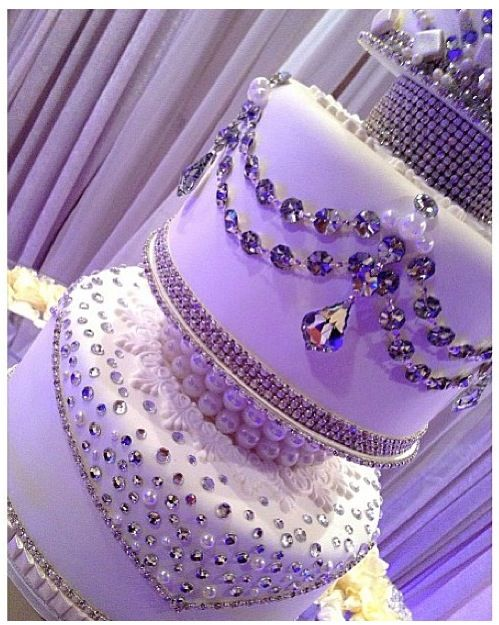 Extravagant wedding cake. Reminds me of Kim Kardashian's wedding headpiece. I love it.  This is not my picture. It was found on Instagram. Photographer unknown.