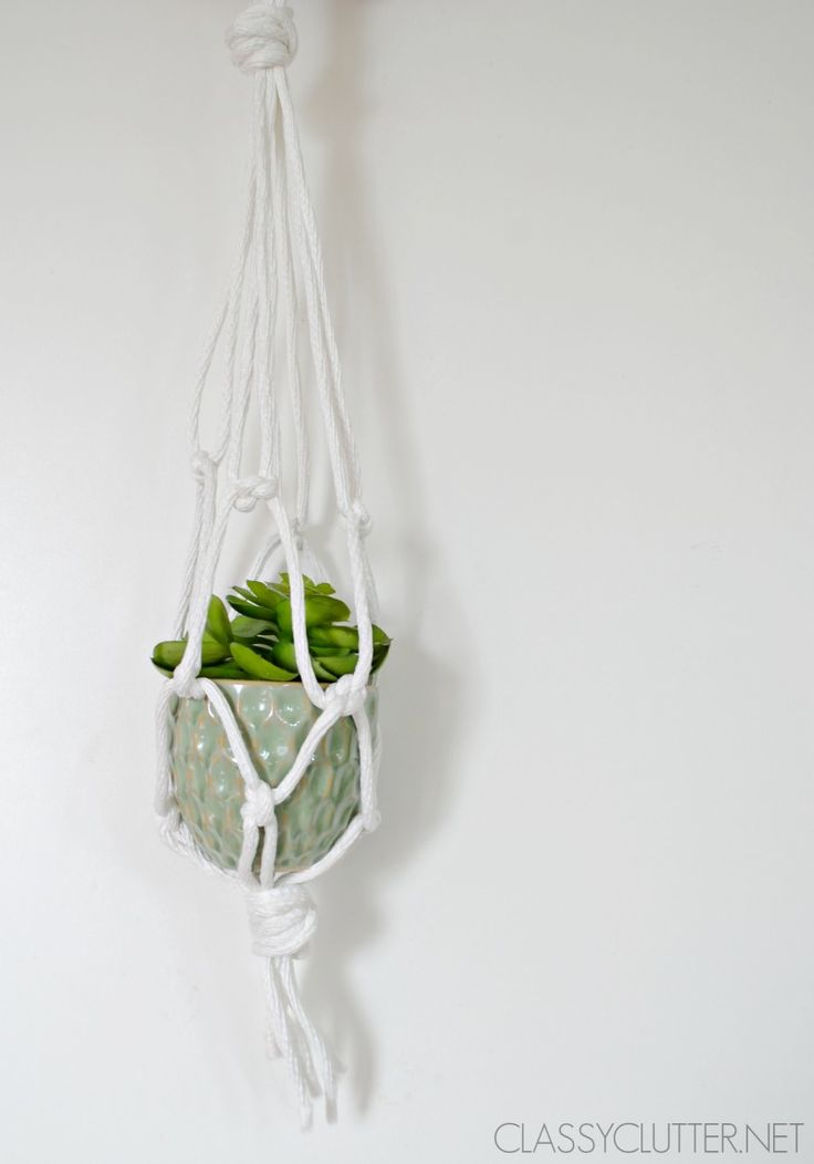 DIY Macramé Hanging Planters that are so adorable and fun! These simple hanging planters change up  a room! Click for the tutorial