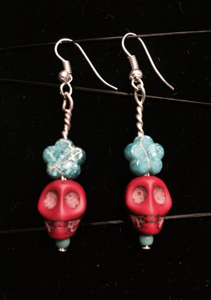 Halloween earrings. Red skull and turquoise flower. Frida Kahlo style