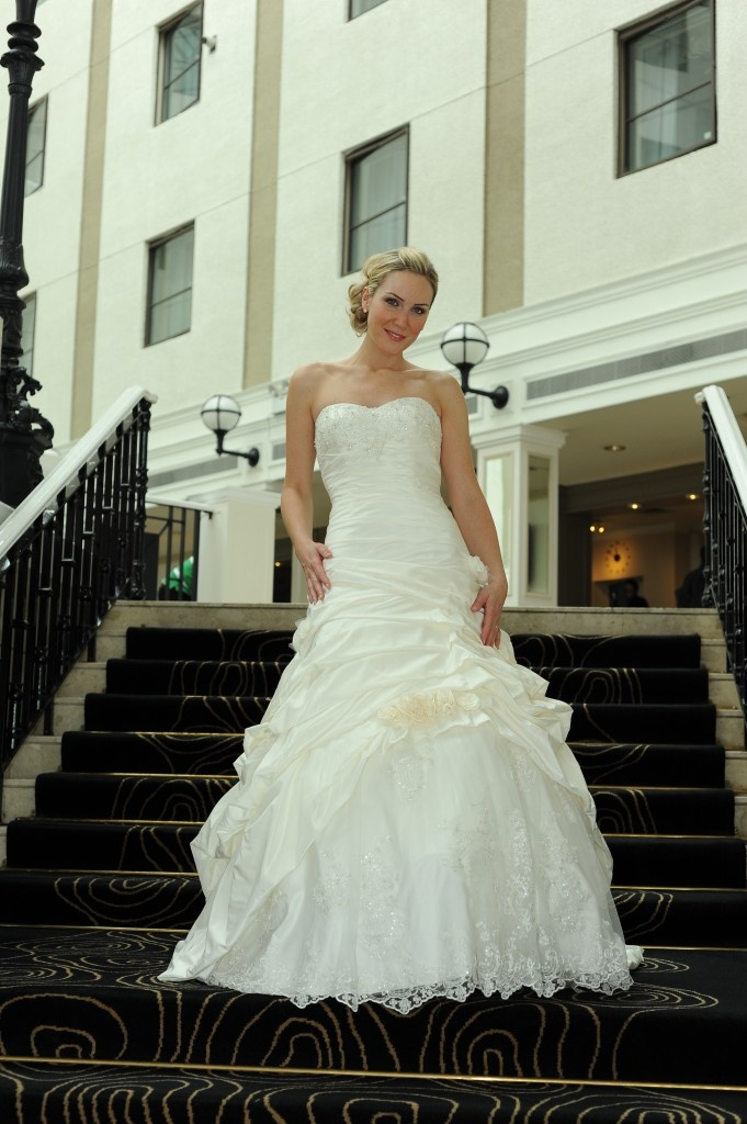 Natalie poses outside the Thistle Hotel Brighton in another strapless wedding dress