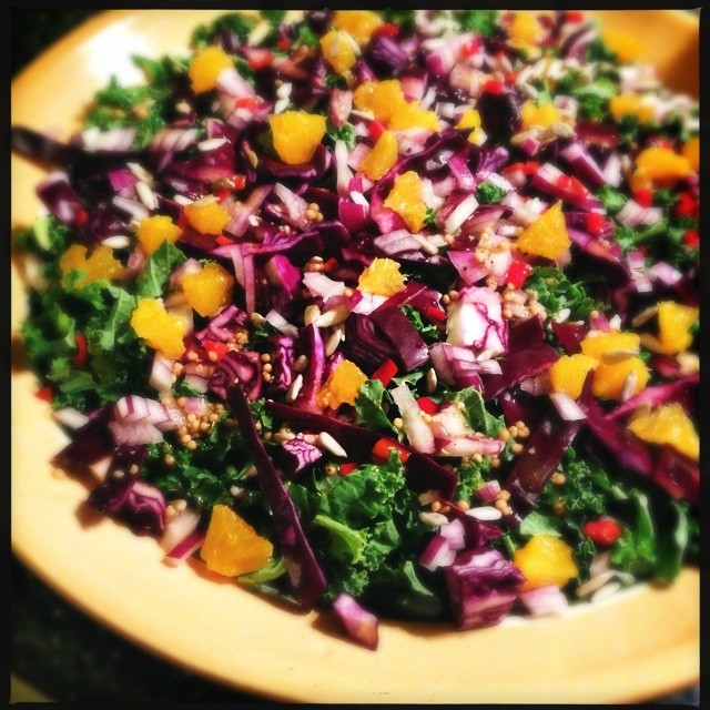 Colourful salad with kale, red cabbage, red pepper, mandarins and a balsamic dressing
