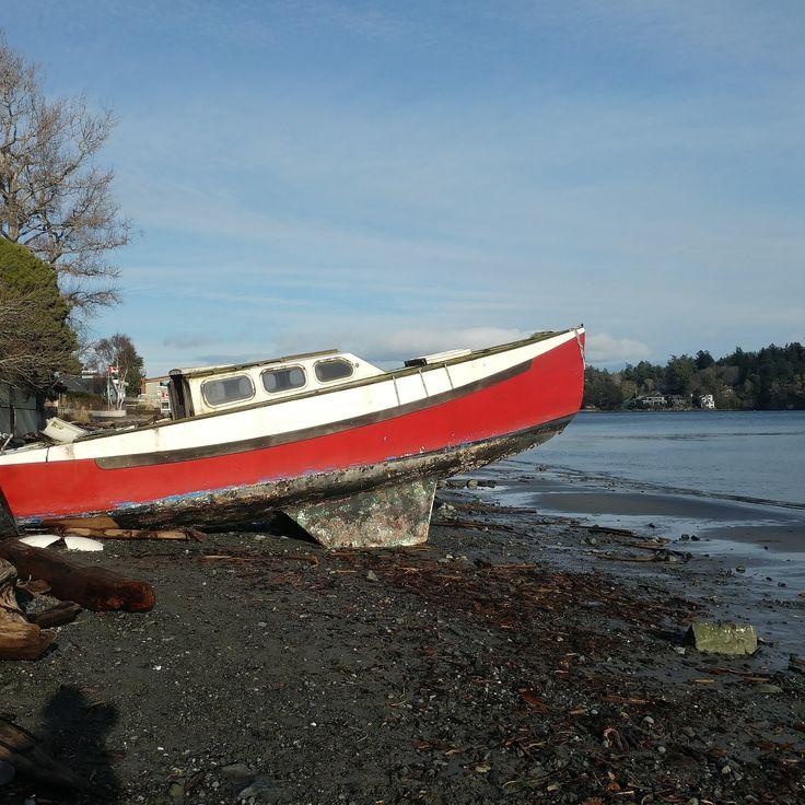 Unfortunate boat on Gyro Beach, Cadboro Bay, Victoria BC after a winter storm. #gyrobeach #caddybay #yyj #saanich