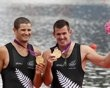 New Zealand's Nathan Cohen (L) and Joseph Sullivan smile with their gold medals at the victory ceremony after winning the men's double sculls finals rowing event during the London 2012 Olympic Games at Eton Dorney August 2, 2012. REUTERS/Darren Whiteside (BRITAIN - Tags: OLYMPICS SPORT ROWING) - http://www.PaulFDavis.com/success-speaker (info@PaulFDavis.com)