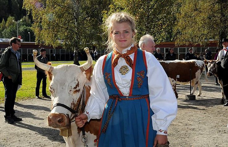 Girl with telemark costume (bunad) and Telemark cow in Seljord, Norway. - From THE ESSENCE OF THE GOOD LIFE™ - https://www.facebook.com/pages/The-Essence-of-the-Good-Life/367136923392157