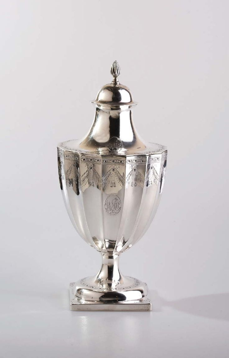 """Paul Revere, Patriot (1734-1818): Rare and Important Boston Federal Silver Sugar Urn and Cover, Circa 1800 - Of cylindrical form, engraved with a border of medallions suspending tasseled drapery swags beneath a vine border at the rim, an oval medallion enclosing the initials """"WMH"""" in foliate script & date """"1800,"""" the circular foot with matching vine border above the square base engraved with a tripartite leaf at each corner... marked """"REVERE"""" within rectangle on one side of the base. H 9 1/4…"""