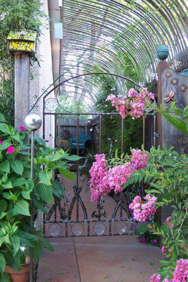 Deborah Kinchloe's Garden. Beautiful secret garden arbor of redwood lathe with copper art gate entrance. A delightful spot to relax, read, or paint.