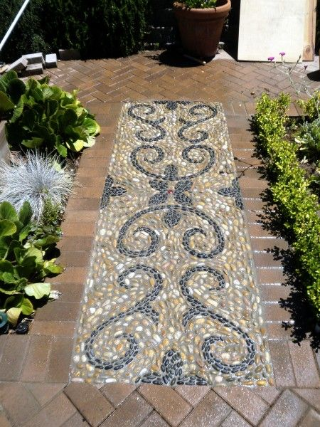 Baroque Curves Medium: beach pebbles and glazed ceramic button