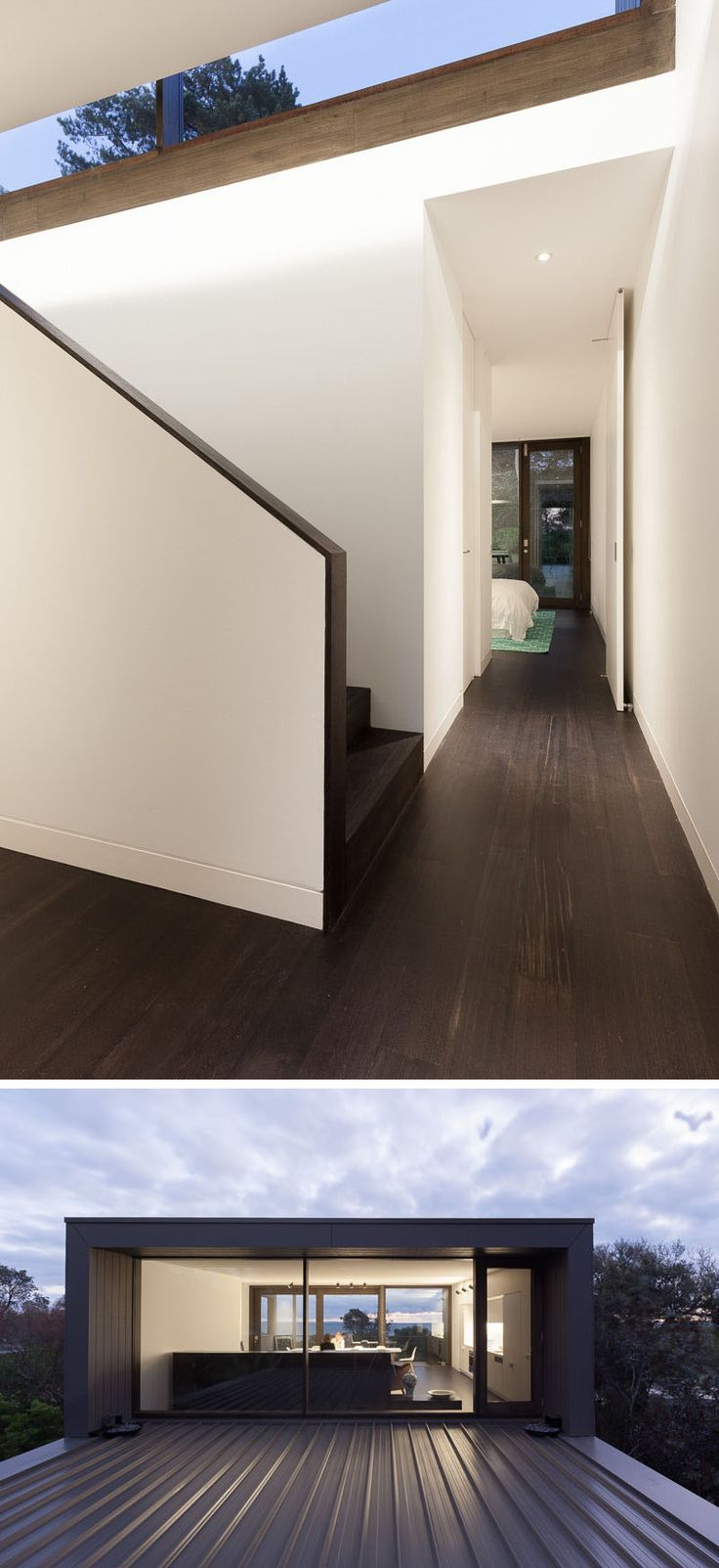 Dark hardwood flooring is featured throughout this modern house contrasts the white walls. Heading upstairs, the common areas of the home are revealed. At the top of the stairs, there's the option of going into the living area, or accessing the roof through a glass door.