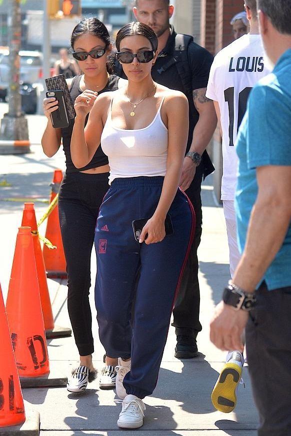 fe2aef455 Kim Kardashian wearing Yeezy Season 4 Calabasas Sweatpants, Naked Wardrobe  Tank Me Away Bodysuit in White, Adidas Yeezy Calabasas Powerphase Sneakers  and ...