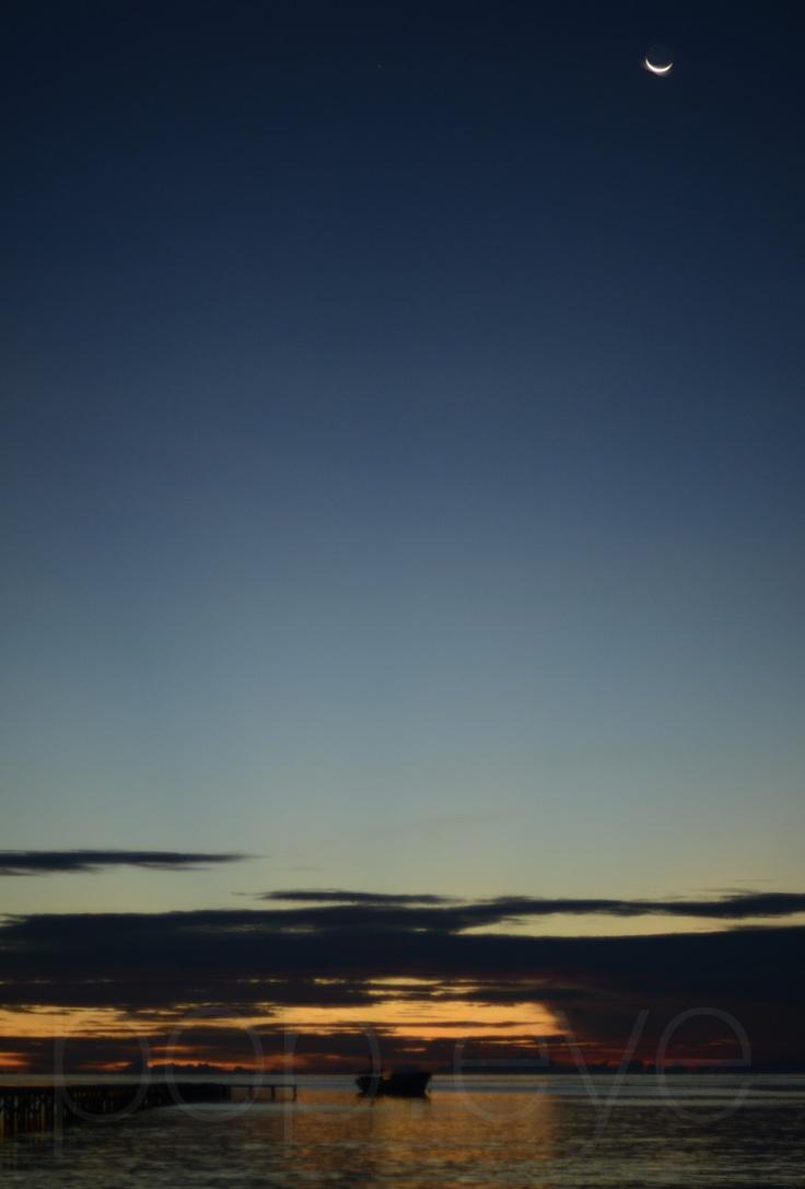 When the moon meets the sun..  Near Sabbakatang Island, Balak-Balakan Islands, Kalimantan