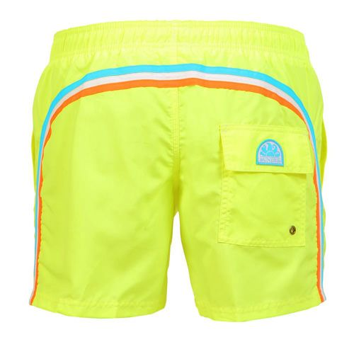 FLUO YELLOW MID-LENGTH SWIM SHORTS WITH ELASTIC WAIST AND RAINBOW BANDS Fluo yellow mid-lenght Boardshorts with the three classic rainbow bands on the back. Elastic waistband with adjustable drawstring. Internal mesh. Two front pockets. A Velcro back pocket. Sundek logo on the back. COMPOSITION: 100% POLYESTER. Our model wears size 32 he is 189 cm tall and weighs 86 Kg.