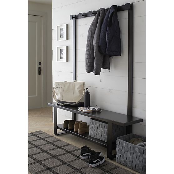 Representing a new generation of outerwear storage, our contemporary hall tree bench and coat rack are crafted entirely of iron with a durable gunmetal powdercoat finish in rich, dark bronze. Simple styling creates a handy nook for sitting down to change footwear, with a convenient lower storage shelf, while the coat rack frames the bench with stable, square hooks to hang coats and hats, scarves and umbrellas, bags and leashes. Coat rack can also be wall-mounted.