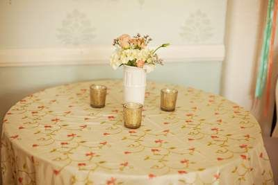 Coral, green, and ivory Asian Vine linens