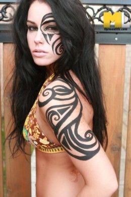Tribal makeup on face and arm http://makinbacon.hubpages.com/hub/tribalmakeupdesigntutorialshalloween