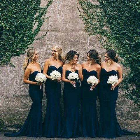 Bridesmaids in midnight navy dresses