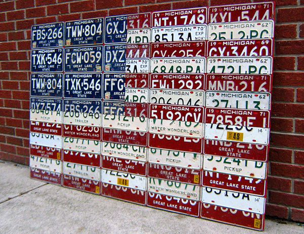 Over 40 vintage Michigan license plates, dozens of hours, some sore hands and 300+ nails later, an American flag is created! This piece of art will be hanging in a proud ex-Detroiter's man cave in Minnesota.