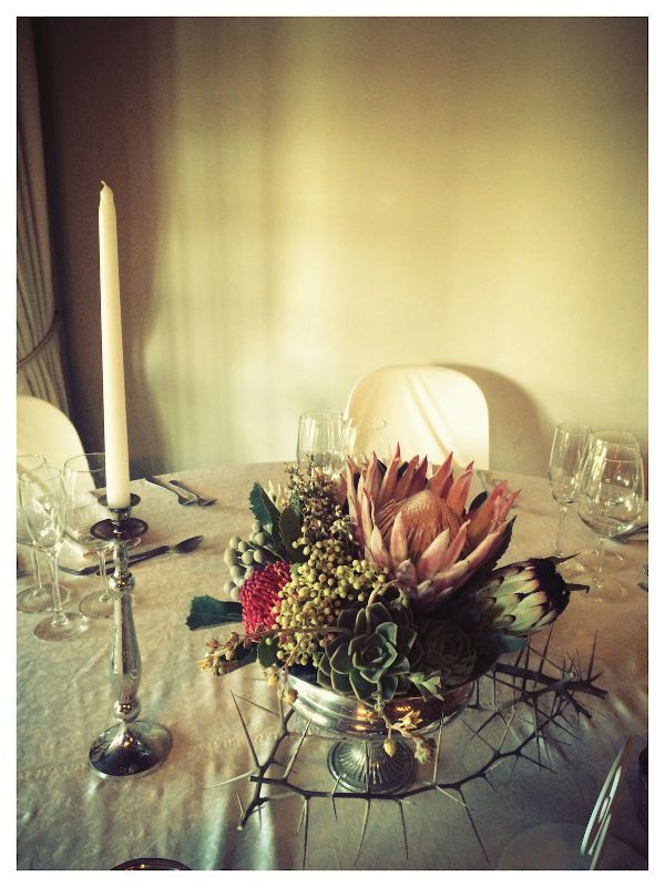 Mixed Protea, Aloe & Succulent Arrangement in Large Silver Rose bowl , w/ Silver candlesticks & Metallic Votives- Guest Tables