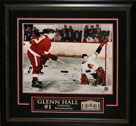 """Glenn Hall Signed 16"""" x 20"""" Etched Mat Blackhawks vs Gordie Howe - Mats by Sports Memorabilia. $390.74. Makes a Great Gift!. This unique frame features a Glenn Hall hand-signed 16"""" x 20"""" game action photo and a laser etching of the home stadium included on the matting. This item is framed in black wood, and includes a decorative v-groove. Perfect for any home or office and a unique addition to any hockey collection. A Certificate of Authenticity is included. E..."""