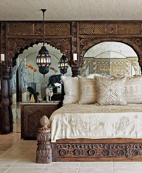 So often heavy traditional furniture would crowd and overpower a room. I've seen architectural pieces used as a headboard before, but never would have concieved of puting a mirror behind them to open up the space. Well done.   martyn lawrence-bullard