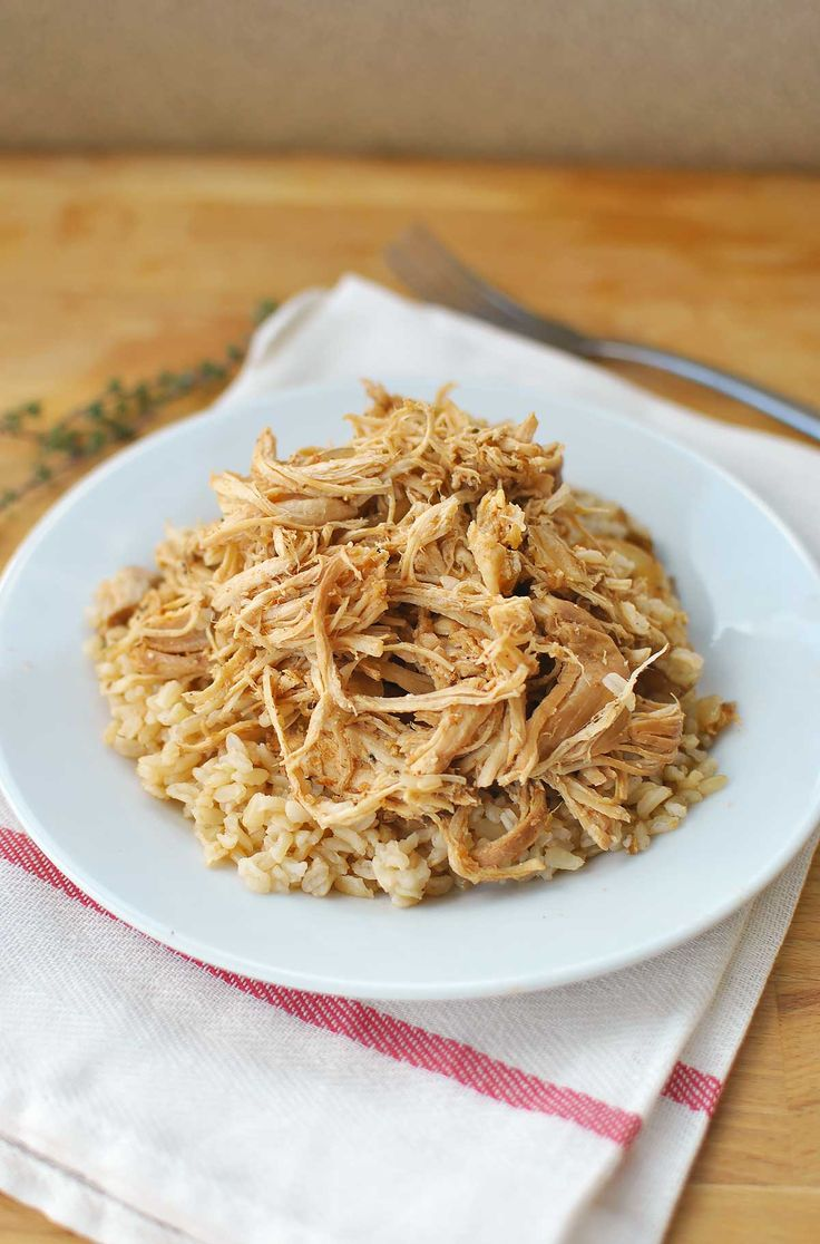 low Cooker Salsa Chicken and Rice might possibly be the easiest meal ever! Boring, weeknight chicken becomes the most popular kid at the table when jazzed up with tangy salsa & spices. Throw some brown rice in your rice cooker and set it to be done when the slow cooker is and dinner is D-O-N-E!!!| Becky's Best Bites
