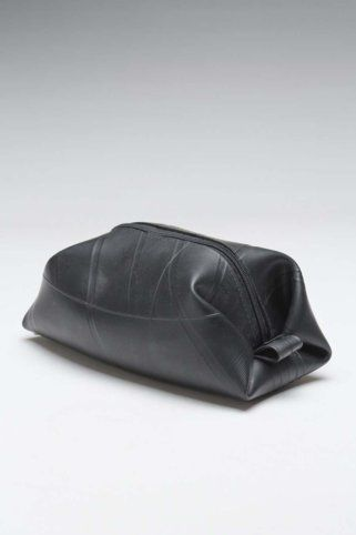 Bag made from recycled bike inner tubes!!! This would make a great toiletry bag