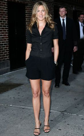 Jennifer Aniston. Black short sleeved shirt, black shorts & heels.