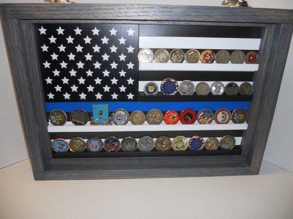 This is a smaller version of my Thin Blue Line Coin Display, size to hold 35-40 challenge coins.  This is a hand-painted, all wood Thin Blue Line Flag Coin Display. The overall dimensions are approximately 18 x 26.  This Challenge Coin Case is framed in antiqued oak, it has a piano hinge on the bottom and two sash latches up top for ease of opening and loading your coins. Easy to hang with hangars already installed.  I make this one to order, takes about two weeks to get it done and then a…