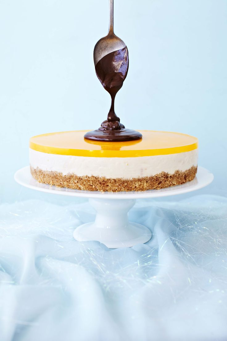 Clementine cheesecake with shiny chocolate sauce. Our most refreshing and tangy cheesecake, the shiny chocolate sauce adds a glossy finish to the light clementine base. Just the recipe for a special occasion.
