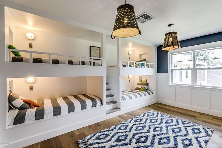 Contemporary Guest Bedroom with Hardwood floors, Paneled wainscoting, Surya Frontier Mediterranean Blue Area Rug, Wall sconce