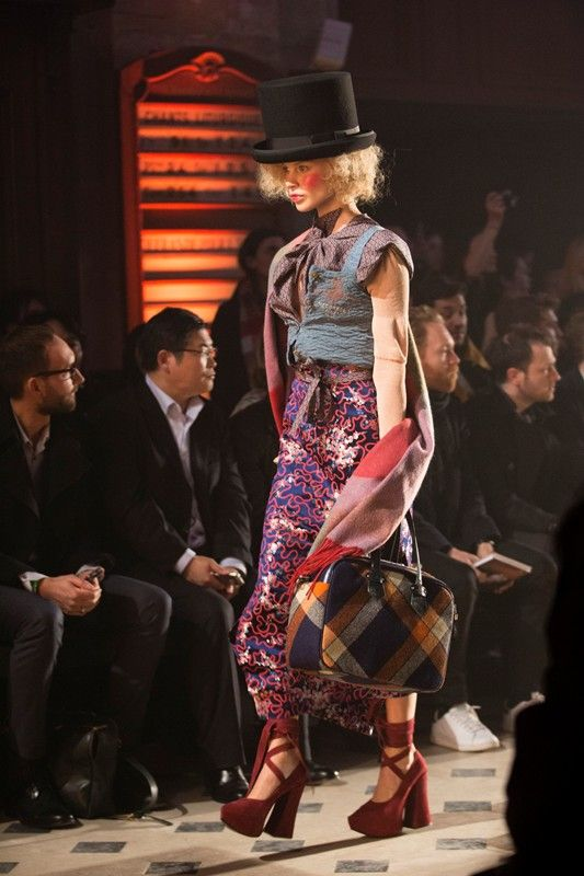 Top hats, tartan and red platform shoes at Vivienne Westwood Gold Label AW14 PFW.