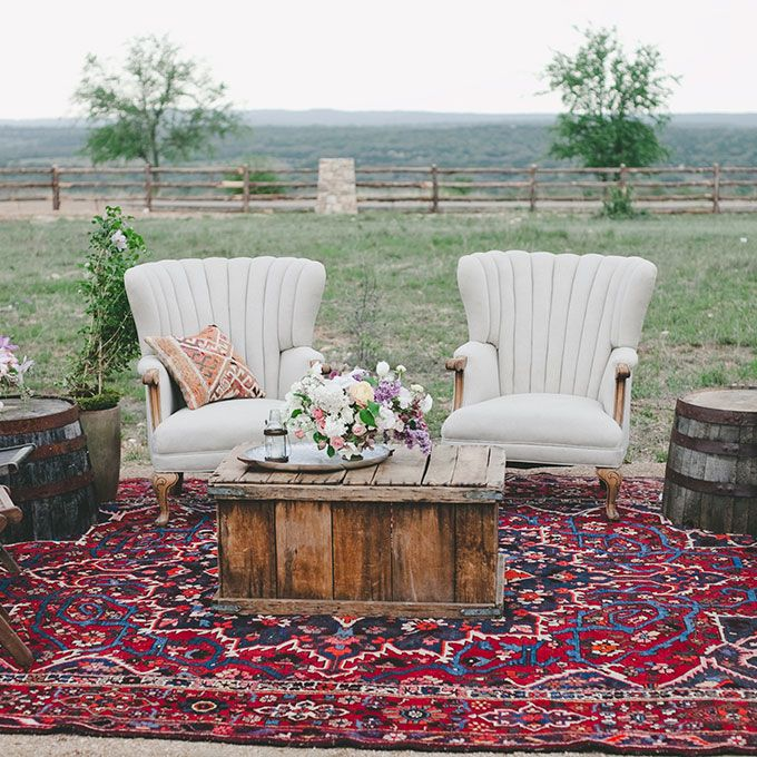 Brides: Wedding Lounge Ideas  rustic lounge area with armchairs and wooden barrel side tables.