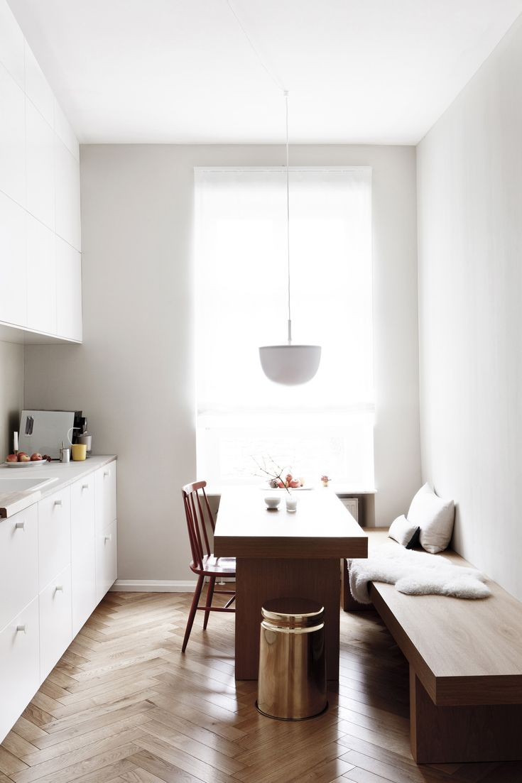Customized Ikea kitchen in a luxe-minimalist apartment remodel by Studio  Oink in Mainz,