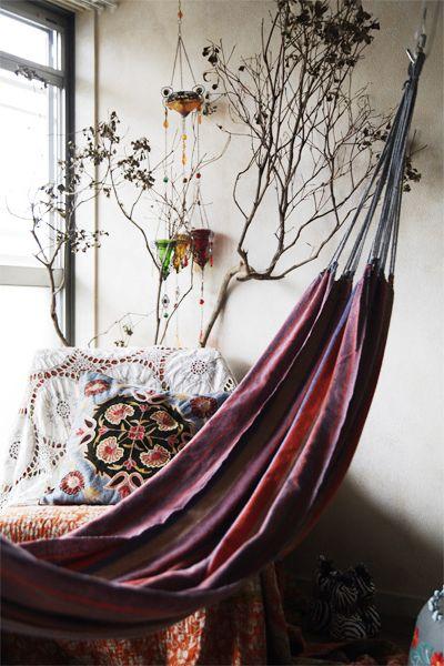 A hammock indoors.