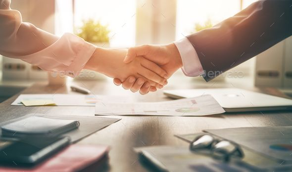 Handshaking In Office By Choreograph Man And Woman Are Shaking Hands In Office Collaborative Teamwork Choreogr Business Stock Images Corporate Design Design