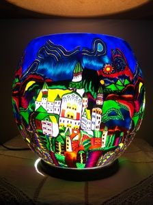 Village Scene Light. A wonderful statement for your home this large globe shaped hand made glass light from Germany with it's blue hues looks stunning. At night your room will take on a magical sight when it's scene comes to life. You could even bring the WOW factor to your alfresco dining.
