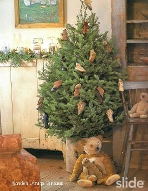 From Seasons at Seven Gates Farm - my home decor bible. This photo inspired me to do the same - to decorate a small tree with my vintage shoe collection.: