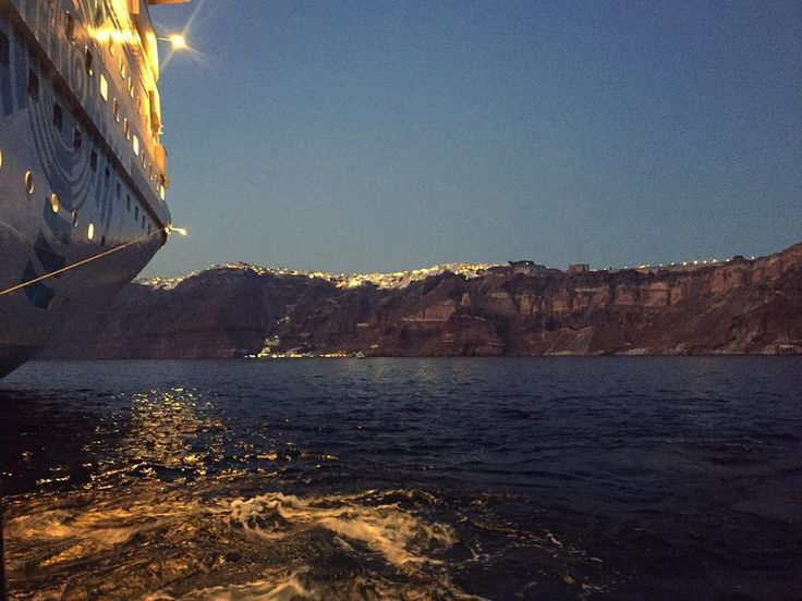 Celestyal Olympia approaching Santorini island..  Day may be over but your adventure is just beginning!  Photo by @geeladygiselle #Celestyalcruises #CelestyalOlympia #Santorini #island #Greece #greekislands