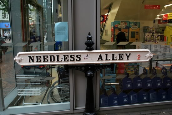 Website uses Asshole alley street sign