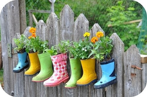 A fun way to decorate outside of the classroom. Each child could bring an old shoe from home and watch plants grow throughout the school year. This will enforce the idea that items can be re-used in several ways